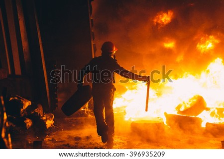 Kiev, Ukraine - 22 January, 2014: Protester burn tires to stop the riot police, because Ukrainian police want to storm the main anti-government protest camp in the Kiev. Revolution in Ukraine. - stock photo