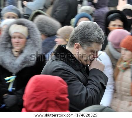 KIEV, UKRAINE -Â?Â? 25 JANUARY 2014: Ukrainian politic Petro Poroshenko visit the burial of Ukrainian revolutionary hero Michail Zhiznevskij on January 25, 2014 in Kiev, Ukraine. - stock photo