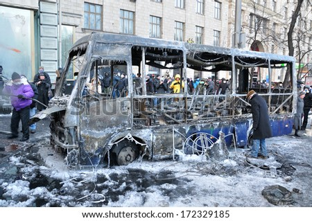 KIEV, UKRAINE - 20 JANUARY 2014: Unknown demonstrators burn and destroy a police bus in government district on January 20, 2014 in Kiev, Ukraine.