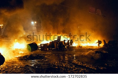 KIEV, UKRAINE - 22 JANUARY 2014: Unknown demonstrators fight with police in government district on January 22, 2014 in Kiev, Ukraine - stock photo