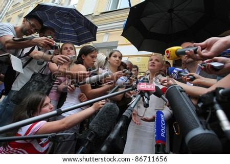 KIEV, UKRAINE - JUL 24: Former Prime of Ukraine Yulia Tymoshenko and journalists in Kiev Pechersk court. Convicted of abuse of power in contracting for gas supplies., Jul. 24, 2011 in Kiev, Ukraine. - stock photo