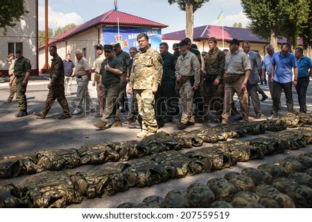 KIEV, UKRAINE - Jul 26, 2014: President of Ukraine Petro Poroshenko examined modern samples of arms and military machines that will be sent to the ATO area