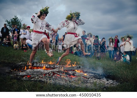 KIEV, UKRAINE - Jul 6, 2016: Slavic celebrations of Ivana Kupala. Young people jump over the flames of bonfires in a ritual test of bravery and faith.