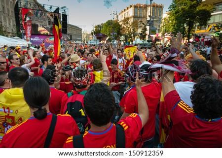 KIEV, UKRAINE - JUL 1: Spanish football fans prepare on the central fun zone for EURO 2012 final match Spain vs. Italy on July 1, 2012 in Kiev, Ukraine - stock photo