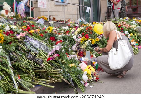 Kiev, Ukraine - July 18, 2014. People brought flowers and toys to the embassy of the Netherlands after the Malaysia Airlines B-777 (MH17) was shot down over Donetsk Region. - stock photo