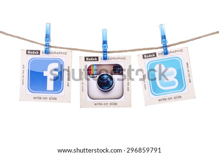 KIEV, UKRAINE - JULY 05, 2015: Popular social media Facebook,Instagram, Twitter hanging on the clothesline on white background. - stock photo