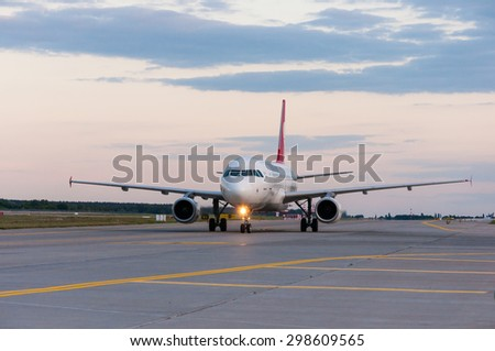 KIEV, UKRAINE - JULY 10, 2015: Turkish Airlines Airbus A320 taxiing to the gate after landing at the Borispol international airport - stock photo