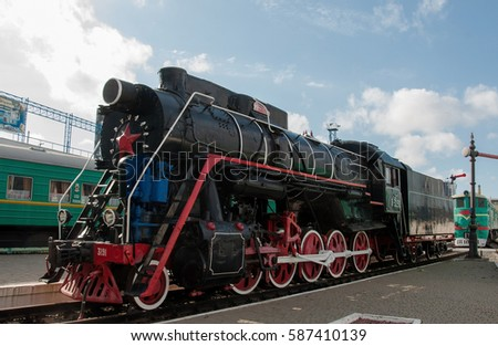 KIEV, UKRAINE - JULY 04, 2016 : view of historical old steam locomotive exhibited in train museum. Black retro steam train. Railway. The old steam locomotive in open air museum. Oldtimer.