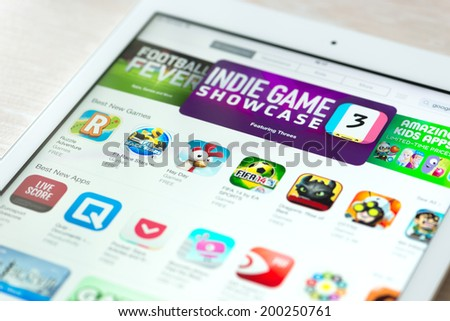 KIEV, UKRAINE - JUNE 05, 2014: Brand new Apple iPad Air with featured mobile games apps in App Store collection. App Store is a digital distribution service for mobile apps, developed by Apple Inc. - stock photo