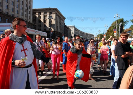 "KIEV, UKRAINE - JUNE 24: English knights and fans play football in Fan-Zone of Euro 2012 on June 24, 2012 in Kiev, Ukraine. The slogan of EURO 2012 Football Championship is ""Creating History Together"""
