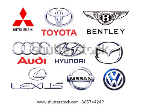 KIEV, UKRAINE - June 7, 2015: Logos collection of different brands of cars, printed on paper and placed on white backgroun.