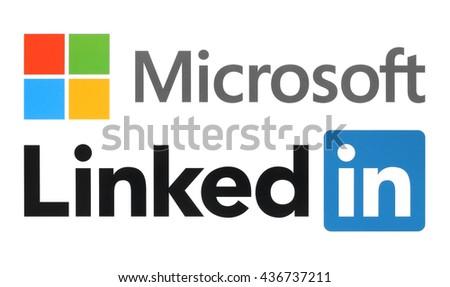 Kiev, Ukraine - June 13, 2015: Microsoft and Linkedin logos printed on white paper. - stock photo