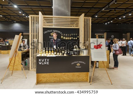 KIEV, UKRAINE - JUNE 04, 2016: Presenter works on Chateau Dereszla Tokaj wine from Hungary booth at Kyiv Wine Festival organized by Good Wine company in Parkovy Exhibition Center.