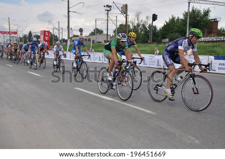 "KIEV, UKRAINE - 1 JUNE 2014: Unknown cyclists from different teams take part in competition ""Horizon Race Park"" on June 1, 2014 in Kiev, Ukraine."