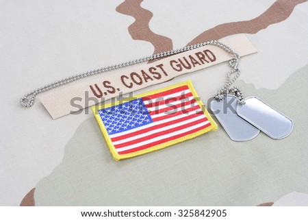 KIEV, UKRAINE - June 14, 2015. US COAST GUARD branch tape with dog tags  and flag patch on desert camouflage uniform