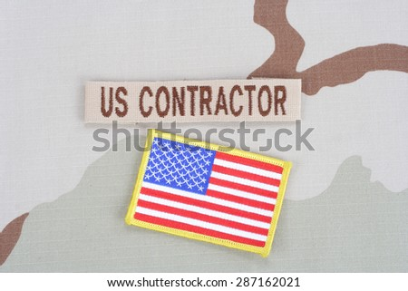 KIEV, UKRAINE - June 14, 2015. US CONTRACTOR branch tape and flag patch on desert camouflage uniform