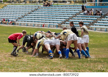 KIEV, UKRAINE, KIEV -JUNE 12: Unidentified Rugby players in action at a Ukrainian National Championship rugby match, Antares (in black) vs. Argo (in yellow) on June 12, 2011 in Kiev, Ukraine. - stock photo