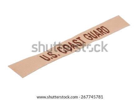 KIEV, UKRAINE - Mar. 29, 2015. Illustrative editorial. US COAST GUARD branch tape uniform badge isolated on white background