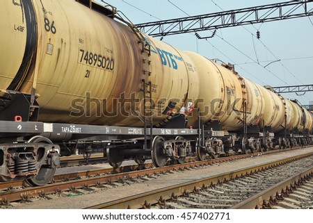 Kiev, Ukraine - March 11, 2015: Cargo train with oil tanker cars on the railway track