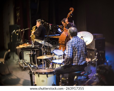 "KIEV, UKRAINE - MARCH 21, 2015: Ethno-music performer Myron Bloschychak   were accompanied by the trio of Vladimir Solyanik, 14 international jazz festival ""Unity"". - stock photo"