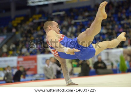 KIEV, UKRAINE - MARCH 31: Filip Ude, Croatia performs the floor exercise during International Tournament in Artistic Gymnastics Stella Zakharova Cup in Kiev, Ukraine on March 31, 2013