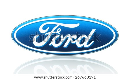 KIEV, UKRAINE - MARCH 21, 2015: Ford logo printed on paper and placed on white background. Ford Motor Company is an American multinational automaker. - stock photo