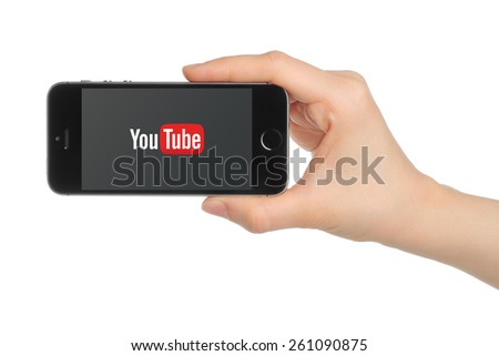 KIEV, UKRAINE - MARCH 7, 2015:Hand holds iPhone 5s Space Gray with YouTube logo on white background. YouTube is a video-sharing website - stock photo