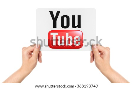 KIEV, UKRAINE - MARCH 08, 2015: Hands hold the paper with YouTube logotype printed on paper. YouTube is a video-sharing website headquartered in San Bruno, California.