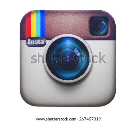 KIEV, UKRAINE - MARCH 08, 2015: Instagram logotype camera printed on paper. Instagram is an online service that enables its users to share pictures and videos on social networking platforms. - stock photo