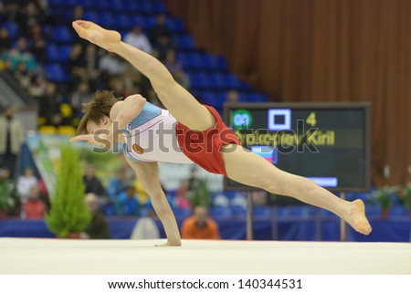 KIEV, UKRAINE - MARCH 31: Kiril Prokopiev, Russia performs floor exercise during International Tournament in Artistic Gymnastics Stella Zakharova Cup in Kiev, Ukraine on March 31, 2013