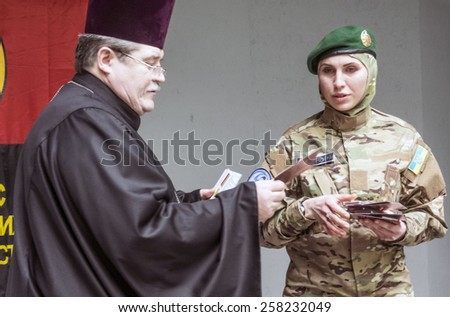 """KIEV, UKRAINE - March 4, 2015: Medal """"For the sacrifice and love for Ukraine"""" were awarded today, 46 soldiers from the Battalion of Dzhokhar Dudayev, UNA-UNSO, """"Right Sector"""", """"Donbass"""", """"Azov"""", etc - stock photo"""