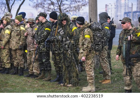 "KIEV,UKRAINE - March 26 : Members of military exercises in uniform and with models of weapons before the start of military training for civilians ""RUH 100.Tryzub"" in Kiev,Ukraine on March 26,2016."