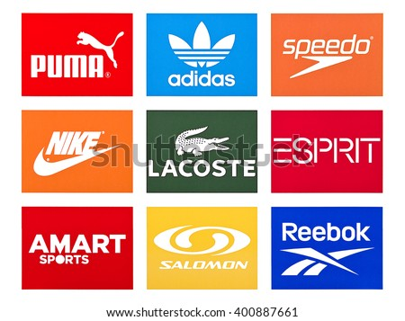Kiev, Ukraine - March 31, 2016: Set of most popular logos of brands clothing printed on white paper: Adidas, Puma, Reebok, Speedo,  Lacoste,  Hennes & Mauritz, Salomon, Amart, Espirit.