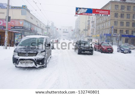KIEV,UKRAINE-MARCH 22: street of kiev are paralyzed by a blizzard on 22nd of march,2013, in Kiev,Ukraine. The Ukrainian capital has been beaten by the biggest snowstorm in the last 10 years - stock photo