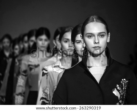 KIEV, UKRAINE - MARCH 18, 2015: The model shows a new collection of Lilya Poustovit the 36th Ukrainian Fashion Week.  - stock photo