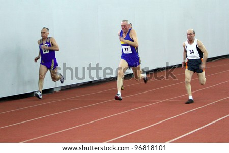 KIEV, UKRAINE - MARCH 03: Unidentified men at the 60 meters dash race on the Ukrainian Veterans Track and Field Championships on March 03, 2012 in Kiev, Ukraine.