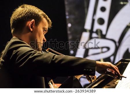 "KIEV, UKRAINE - MARCH 21, 2015:Violinist of the National Presidential Orchestra of Ukraine. 14 international jazz festival ""Unity"". - stock photo"