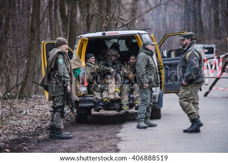 "KIEV,UKRAINE - March 26 : Volunteers in uniform sitting in truck during military training ""RUH 100.Tryzub"" for civilians in Kiev,Ukraine on March 26,2016."