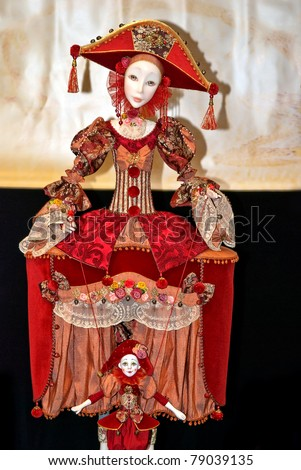 KIEV, UKRAINE - MAY 22: A collectible doll, which resembles red harlequins, is on display at the Kyiv Fairy Tale exhibit in the 2nd annual International Doll Salon on May 22, 2011 in Kiev, Ukraine.