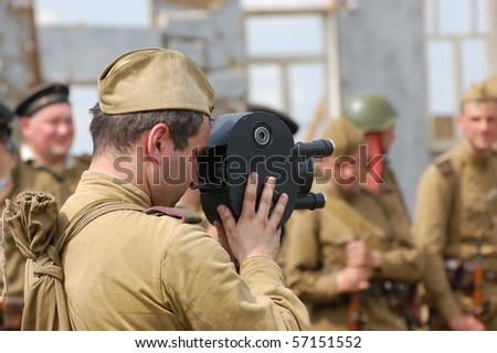 KIEV, UKRAINE - MAY 10 : A member of Red Star history club wears historical Soviet uniform during historical reenactment of 1945 WWII, May 10, 2010 in Kiev, Ukraine - stock photo