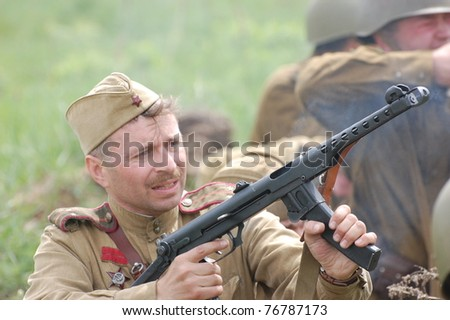 KIEV, UKRAINE - MAY 8 : A member of Red Star history club wears historical Soviet uniform during historical reenactment of WWII on May 8, 2011 in Kiev, Ukraine