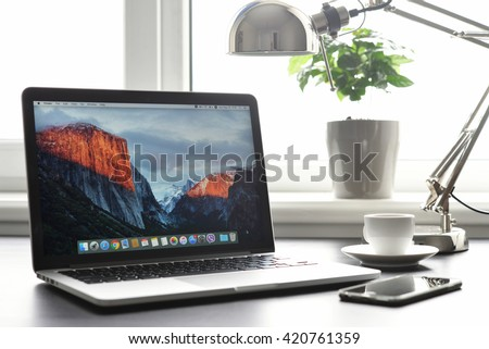 Kiev, Ukraine - May 15, 2016:Brand new Macbook Pro with with Retina display and OS X EL Capitan on table. MacBook is a brand of notebook computers manufactured by Apple Inc.