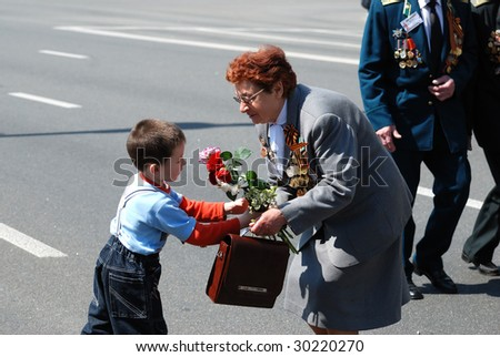 KIEV, UKRAINE - MAY 9: Ceremonial parade of victory on main Khreshchatyc street dedicated to the 64th anniversary of victory in World War II May 9, 2009 in Kiev. - stock photo