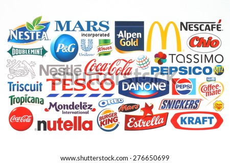KIEV, UKRAINE - MAY 07, 2015:Collection of popular food companies and brand logos printed on paper:Coca-Cola, Mars Incorporated, Kraft, Pepsi, Nestle, Pepsi and others. - stock photo