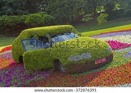 KIEV, UKRAINE - MAY 26, 2013: Flower cars exhibition at Singing meadow in Kiev, Ukraine. - stock photo