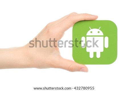 Kiev, Ukraine - May 18, 2016: Hand holds Android logo printed on paper on white background.