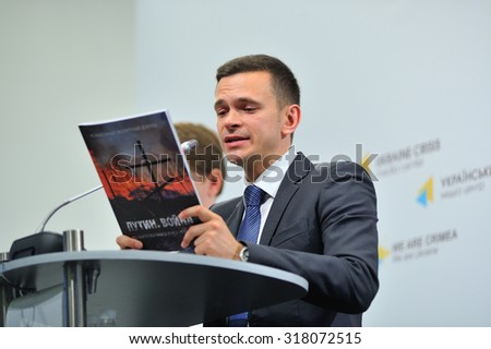 "KIEV, UKRAINE - May 26, 2015: Ilya Yashin - a Russian activist, liberal politician, a close associate of Boris Nemtsov - presents a report on the military conflict in the east of Ukraine, ""Putin. War"""