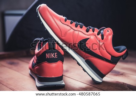 Kiev, Ukraine - May 19, 2016: male red running shoes, training, showing the Nike logo, illustrative editorial,  style fashion