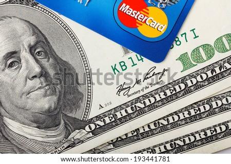 KIEV, UKRAINE - May 18: MasterCard credit card with US dollar bills, in Kiev, Ukraine, on May 18, 2014. - stock photo