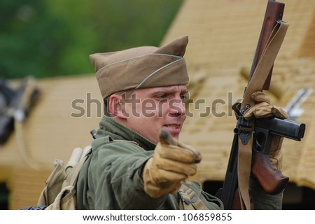 KIEV, UKRAINE -MAY 13: Member of Red Star history club wears historical American uniforms during historical reenactment of WWII, May 13, 2012 in Kiev, Ukraine